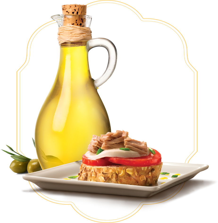 Jar of extra virgin olive oil with a tuna dish