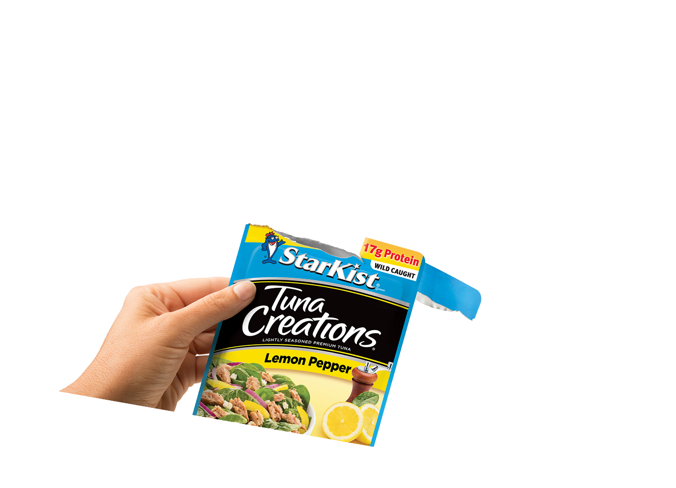 Hand holding a pouch of Starkist Tuna Creations